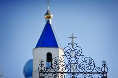 Dome of the Church. Against the blue sky blue dome church with a cross stock image