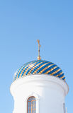 Dome of the church against the sky. Blue and gold dome of the church beautifully shimmers in the sun stock photos