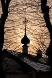 The dome of the church and branches with trees in the foreground stock photos