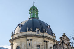 Dome of the church with the cross of the Dominican cathedral in Lviv Stock Images