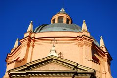 Dome church lit by the morning sun in the city center in Bologna in Emilia Romagna (Italy). Photo made at the dome of a church that is located close to Piazza Stock Photos