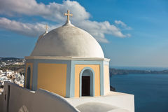 Dome of a church at Oia village with view on Caldera at background, Santorini island Royalty Free Stock Images