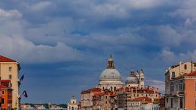Dome of the church of Santa Maria della Salute, and Venetian houses, in Venice, Italy. View of the dome of the church of Santa Maria della Salute, and Venetian stock images