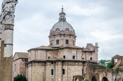 Dome of the church Santi Luca e Martina which is located between the ruins of the Roman Forum and the Forum of Caesar in Rome, Stock Images