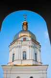 Dome of the church in the window. Orthodox church with a golden dome on a background of blue sky royalty free stock photos