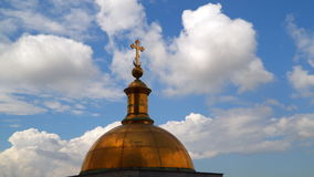 The dome on the colonnade of St. Isaac`s Cathedral against the sky with clouds stock video