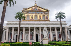 The dome and the courtyard of the Cathedral Church of the Basilica of St. Paul Fuori le Mura with the image of Jesus Christ Stock Photos