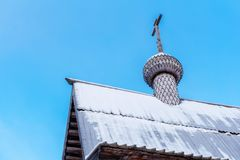 Dome of the old wooden Orthodox church. Dome with a cross of an old entirely wooden Orthodox church against the sky royalty free stock images