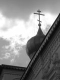 The dome with a cross on the sky background, black and white colors Stock Image