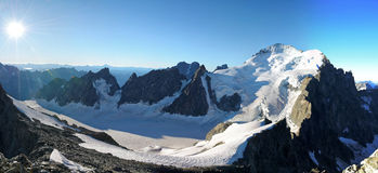 The Dome de Neige des Ecrins and the Glacier Blanc. The Dome de Neige des Ecrins is a summit 4015m located in the Ecrins National Park in France. This picture is Stock Photography