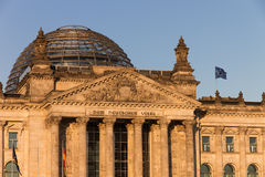Dome and entrance of Berlin's Reichstag. The dome was constructed by Sir Norman Foster, the entrance shows the inscription Dem Deutschen Volke (Dedicated to the Stock Photos