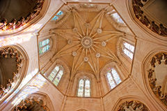 The dome of Founders` Chapel in Batalha Monastery. BATALHA, PORTUGAL - APRIL 30, 2012: The dome of Founders` Chapel in St Mary of Victory Convent decorated with Royalty Free Stock Image