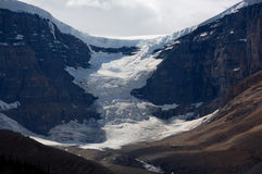 Dome Glacier. Hanging glacier descending down from the Columbia Icefields on Jasper National Park, Rocky Mountains of Canada Stock Photos