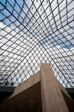 The dome of the glass entrance. Inside the glass pyramid, we can see the beautiful dome Stock Photography