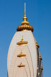 Dome of  the Hindu Temple Radha Madhav Dham. Golden dome of  the Hindu temple and ashram Radha Madhav Dham Royalty Free Stock Images