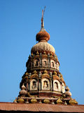 Dome of Indian temple. Decorative dome on the top of an Indian temple.  Blue cloudless sky background Stock Photos