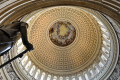 Dome inside of US Capitol, Washington DC. The dome inside of US Capitol in Washington DC beside the statue of George Washington Royalty Free Stock Image