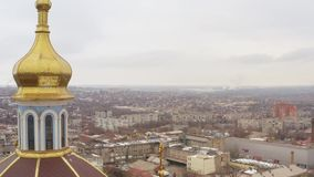 The dome of a large temple in the center of the winter city. Aerial view stock video footage