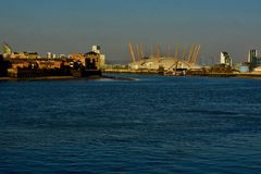 The dome of London O2 arena and the thames river. Viewed from the the thames river is the dome of the O2 Arena in the centre of the picture royalty free stock images