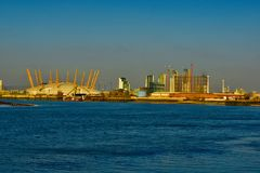 The dome of London O2 arena. Viewed from the the thames river is the dome of the O2 Arena in London stock photography