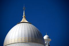 Dome and Minaret of a Mosque Stock Photos