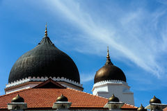 Dome and minarets of masjid Stock Photo