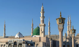 Dome and minarets of nabavi mosque. Exterior view of minarets and green dome of a mosque taken off the compound stock images