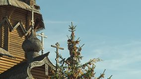 Dome of monastery with crosses and wooden decorative carvings, east Ukraine. Medium shot. Top of fir full of brown cones stock footage