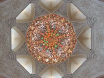 Dome of the mosque. Dome of a mosque in AbuDhabi inside view, Beautiful lighting and floral work stock photo