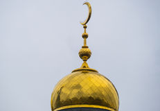 The dome of the mosque with a crescent of yellow metal. Europe's largest mosque in Moscow, Putin open shot in winter on a cloudy day stock photo