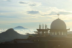 Dome of the mosque. Between landscape Merbabu Mountain look from Temanggung, Central of Java, Indonesia Stock Images