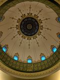 Dome in Mosque Masjid. Dome with Arabic calligraphy in Mosque Masjid with the titles/attributes of God mentioned in Arabic royalty free stock photography
