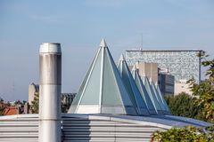 Dome op an roof. Plastic Dome in a row on a metal roof royalty free stock photos
