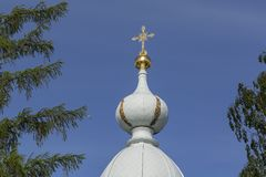 The dome of the Orthodox Church against the blue sky. Concept of religion. Close up stock photo