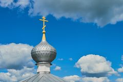 The dome of the Orthodox Church with cross against the blue sky. Russia royalty free stock photo