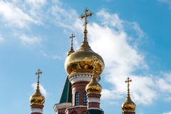 Dome of the Orthodox church with crosses. On a background of blue sky stock image