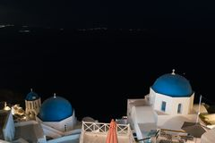 Dome of ortodox church in Oia village at night on Santorini island. Dome of ortodox church in Oia village at night on Santorini island, Greece royalty free stock image