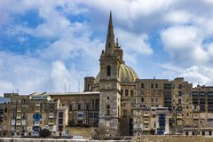 Dome of Our Lady of Mount Carmel church and St Paul`s Cathedral. View at dome of Our Lady of Mount Carmel church and St Paul`s Cathedral in Valletta, Malta royalty free stock photography