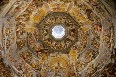 Dome Paintings Cathedral Florence. Duomo Cathedral in Florence Italy seen from the inside looking up to the dome painting of judgement day by Giorgio Vasari in Royalty Free Stock Images