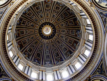 Dome of the Papal Basilica of St. Peter in Vatican City. Designed principally by Donato Bramante, Michelangelo, Carlo Maderno and Gian Lorenzo Bernini, St. Peter royalty free stock images