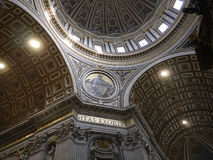 Dome of the Papal Basilica of St. Peter in Vatican City. Designed principally by Donato Bramante, Michelangelo, Carlo Maderno and Gian Lorenzo Bernini, St. Peter Stock Image