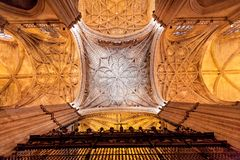 Dome and patterns on ceiling inside 16th century Sevilla Cathedral with vintage decoration and columns. Spain. The largest Gothic church in the world royalty free stock photos