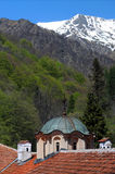 Dome of Rila Monastery and Snowy Mountain Royalty Free Stock Photography