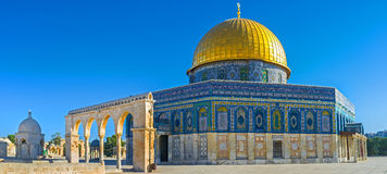 The Dome of the Rock behind the colonnade. Panorama of the Dome of the Rock with the Scales of Souls colonnade and the Dome of Hebron from the left side Royalty Free Stock Photos