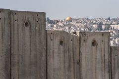 Dome of the Rock and Israeli separation wall. The Dome of the Rock is visible over the Israeli separation wall dividing occupied Palestinian territory in the Stock Photos