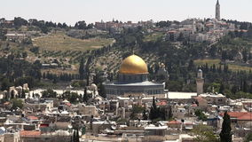 Dome of the Rock Mosque on Temple Mount against mount of Olives in Jerusalem old city, Israel. stock video footage