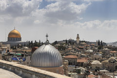 Dome of the Rock, roof-top view Old City Jerusalem. Dome of the Rock, al-Aqsa Mosque, and the silver dome of St. John's Church viewed from the roof of the Royalty Free Stock Photography