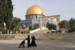 Dome Rock Woman Stroller. Arab woman push a stroller near the Dome of the Rock on Temple Mount in Jerusalem Stock Image