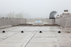 An Dome on the roof in the fog. Plastic Dome of a row house on a flat roof whit fog stock photography