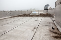 An Dome on the roof in the fog. Plastic Dome of a row house on a flat roof whit fog stock photo